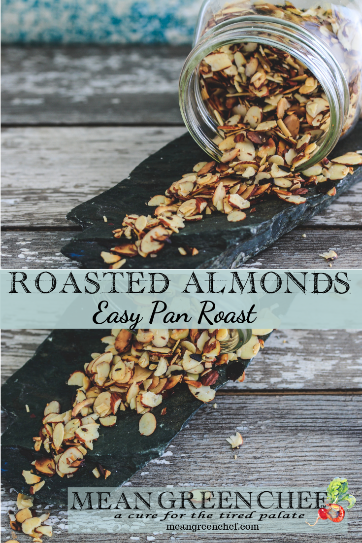 Pan Roasted Almonds scattered on a wooden background