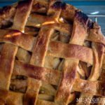 Caramel Apple Pie baked and cooling on a rack on a gray wooden background. Mean Green Chef