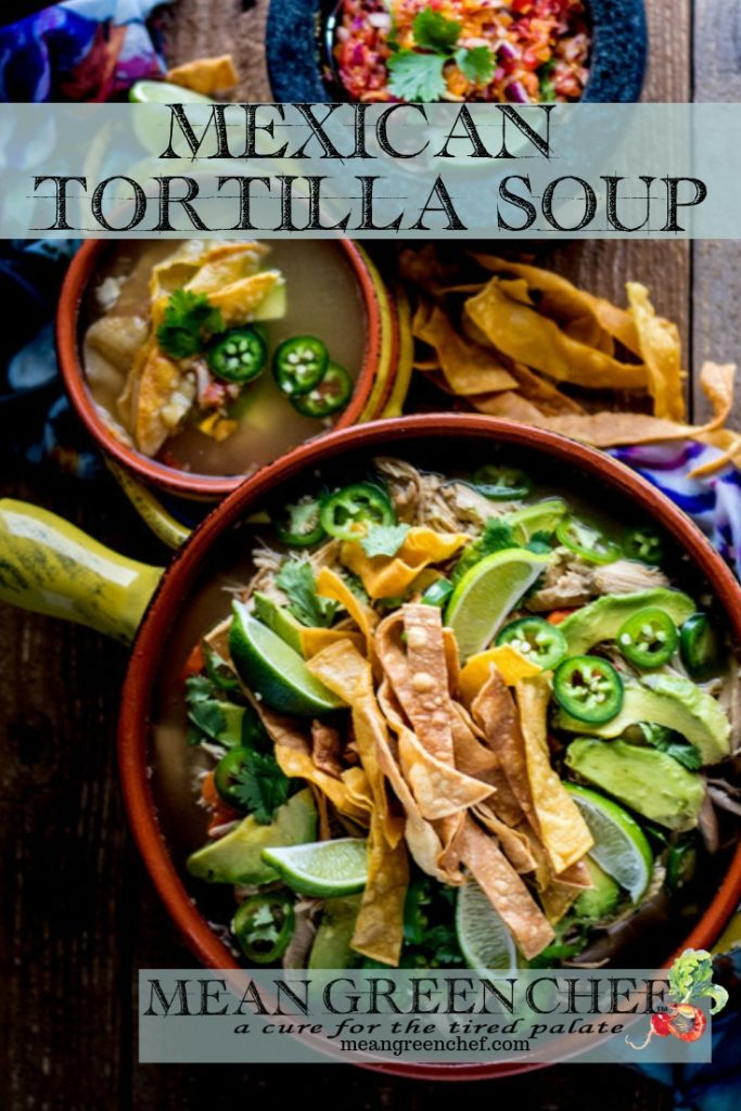 Overhead photo of Mexican Tortilla Chicken Soup Recipe in terracotta pot and bowls with crispy tortilla strips