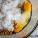 Ingredients for Best Ever Molasses Cookies brown and white sugar with eggs in a large glass bowl. Mean Green Chef