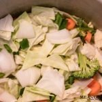 Robust Cabbage Soup ingredients being cooked in a large stock pot on the stove top. Mean Green Chef