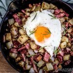 Overhead shot of Restaurant Style Corned Beef Hash topped with a sunny side up eggs