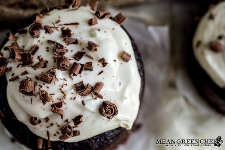 Overhead photo of Guinness Chocolate Cake with chocolate shavings sitting on parchment paper.