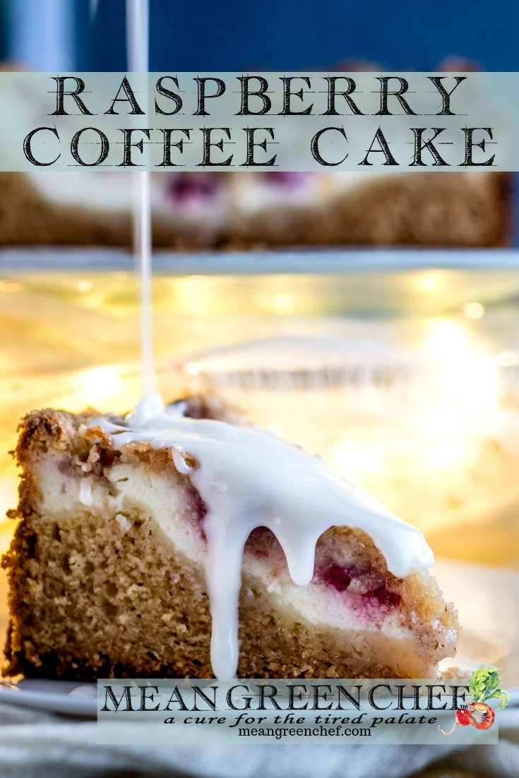 Side photo of Raspberry Coffee Cake with thick vanilla glaze being poured over the top.