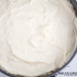 Cream cheese filling that has been spread on top of Raspberry Coffee Cake batter.