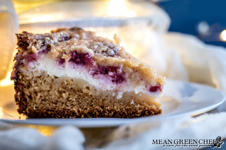 Side photo of Raspberry Coffee Cake showing layers of cheese and berries.