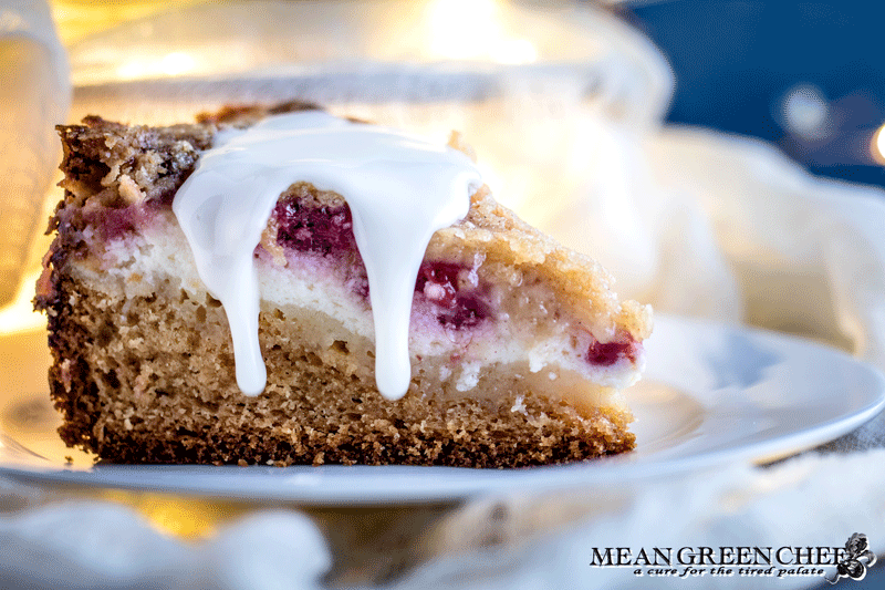 Side photo of Raspberry Coffee Cake with thick dripping vanilla glaze.
