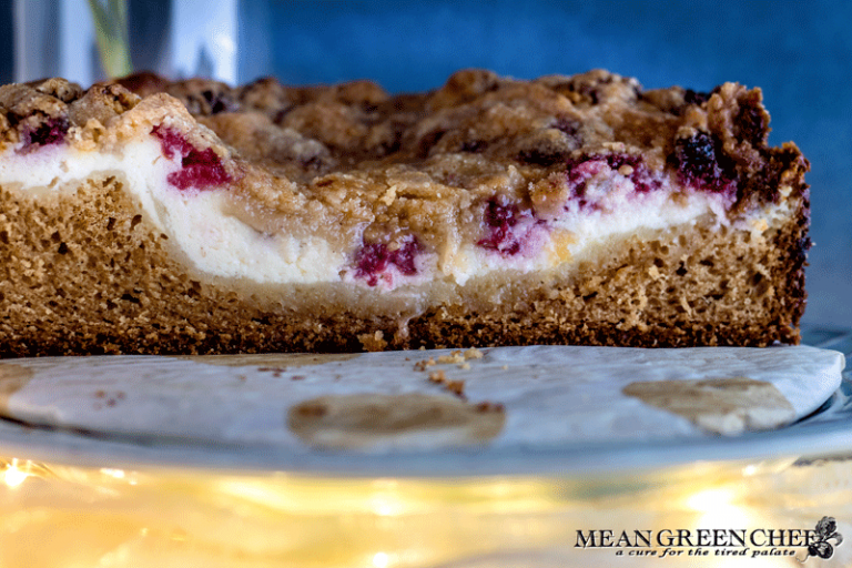 Side photo of Raspberry Coffee Cake showing layers of cheese and raspberries.