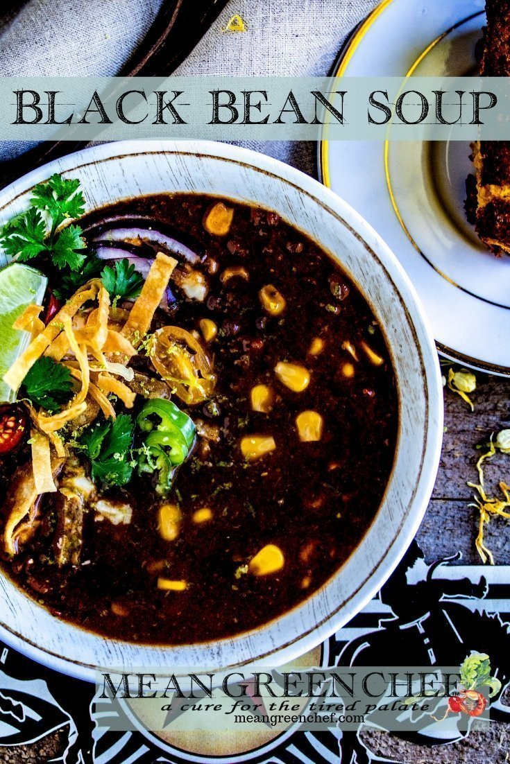Bowl of Black Bean Soup garnished with crispy tortilla strips, jalapenos and cilantro.