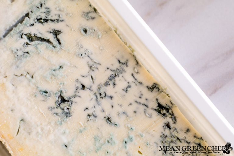 Hunk of Gorgonzola cheese that is being used for Buttermilk Blue Cheese Dressing.