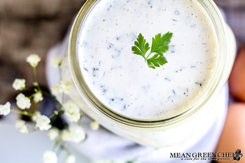Herbed Buttermilk Ranch Dressing in a large mouthed mason jar garnished with green parsley.