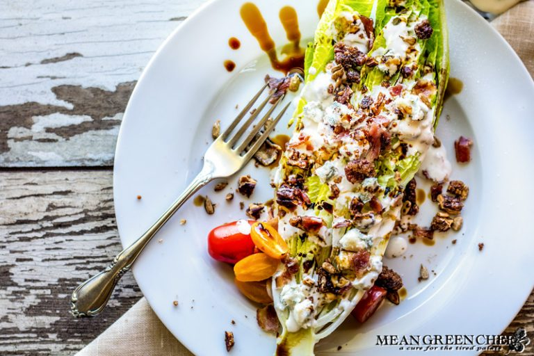 Buttermilk Blue Cheese Dressing poured over a Romaine Wedge Salad with bacon and balsamic vinaigrette.