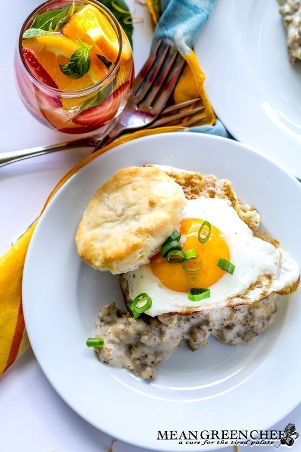 Country Sausage Gravy, served over fluffy buttermilk biscuits and topped with a bright sunny side up egg.
