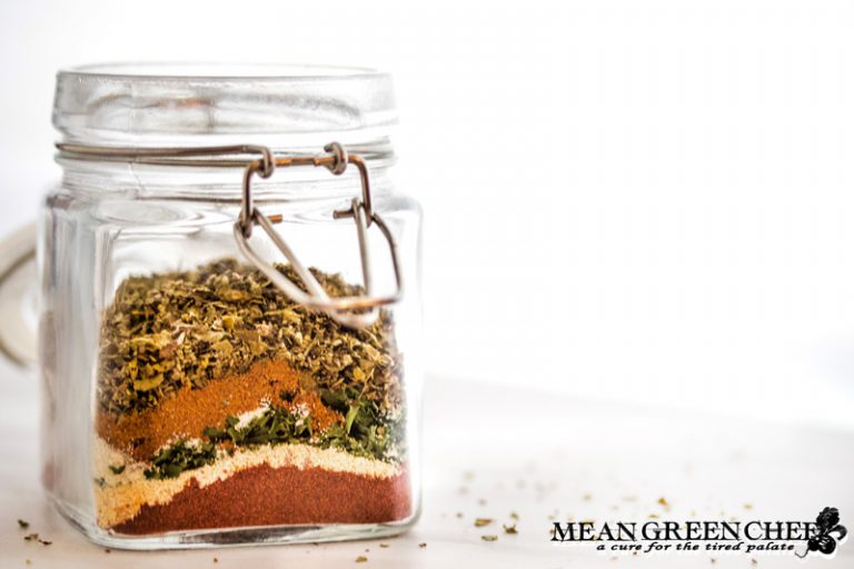 Badass Blackened Seasoning ingredients layered in a jar and ready to be mixed.