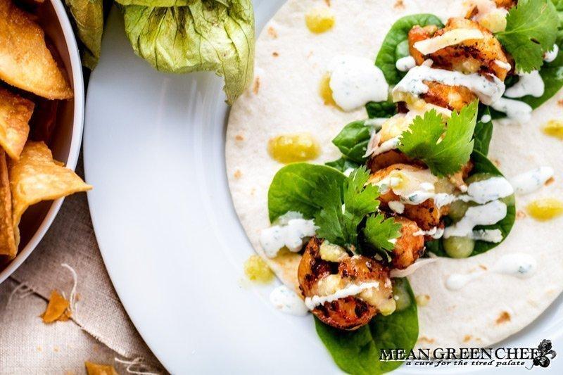 Overhead photo of blackened shrimp taco on a soft tortilla.
