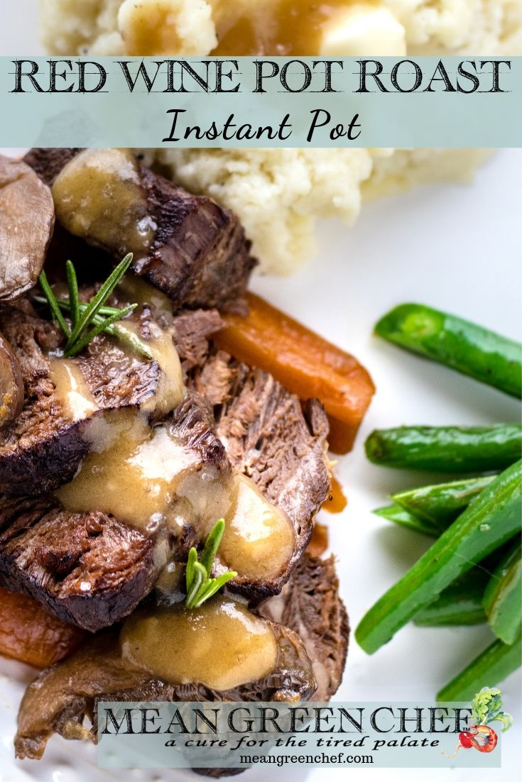 Plate of Red Wine Pot Roast made in the Instant Pot and served with mashed potatoes and sauteed green beans.