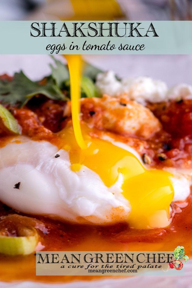 Egg yolk being broken with a fork.