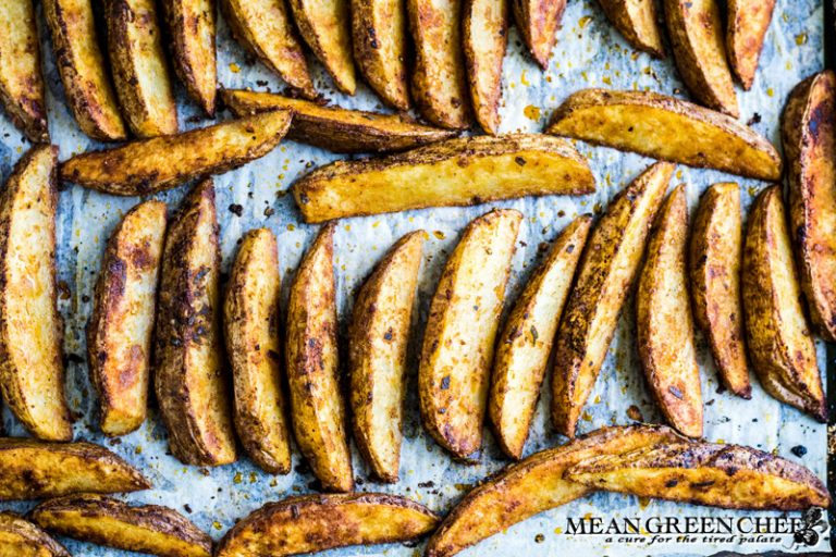 Crispy oven baked fries on a sheet pan just after baking.
