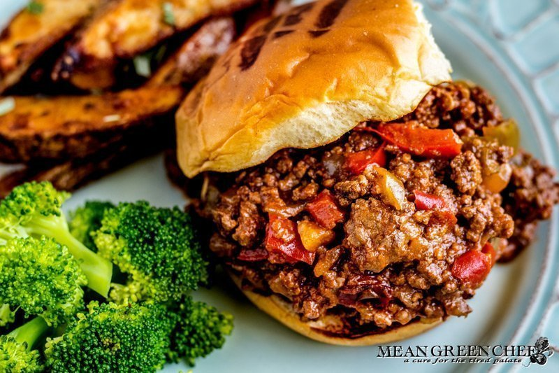 Extra Sloppy Joes on a bun with broccoli and fries.