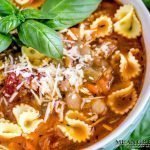 Bowl of Pasta e Fagioli with fresh basil.