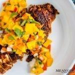 Blackened Chicken with fresh mango salsa in a white bowl.
