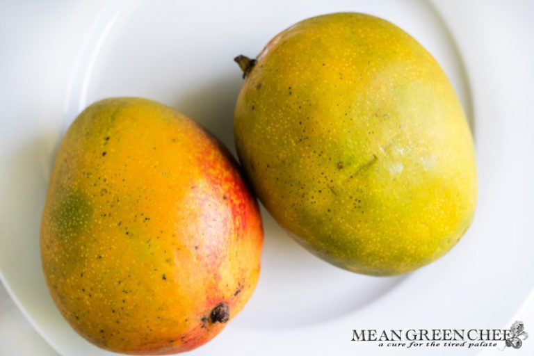Ripe Mangoes on a white plate.
