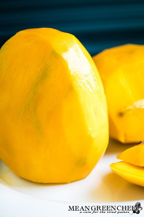 mango standing on end waiting to be cut.