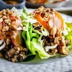 Asian Lettuce Wraps on a white Wedgwood plate.