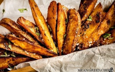 Crispy Oven Baked Fries sprinkled with fresh chopped Rosemary and Kosher sea salt.