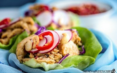 Thai Chicken Lettuce Wraps on a white background with Prik nam pla.